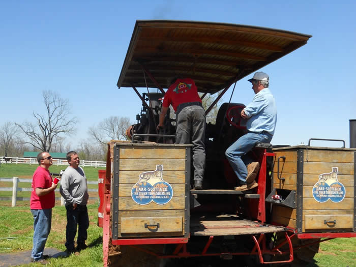 A student learns to operate the feed-water injector on the 25HP Gaar-Scott traction engine.