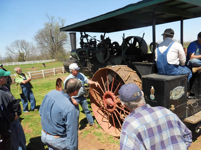 The instructors demonstrate the components and design principles of a 50HP Case traction engine.
